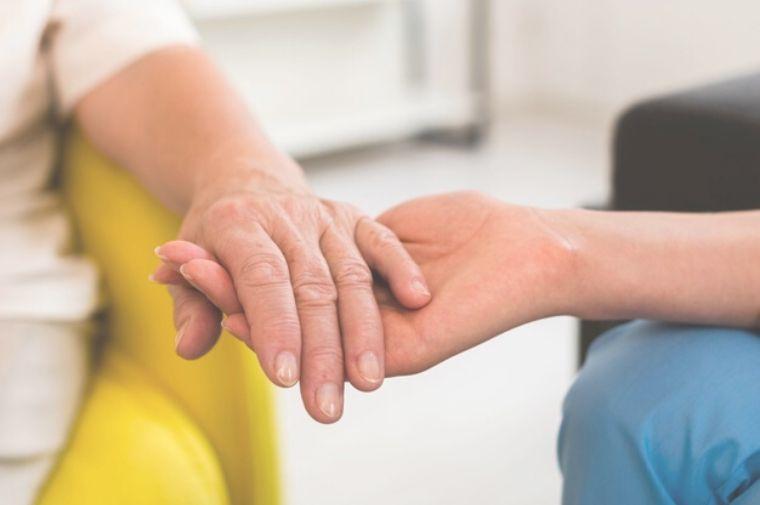 woman-holding-senior-woman-s-hand