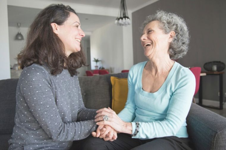 positive-elderly-woman-her-daughter-chatting-laughing